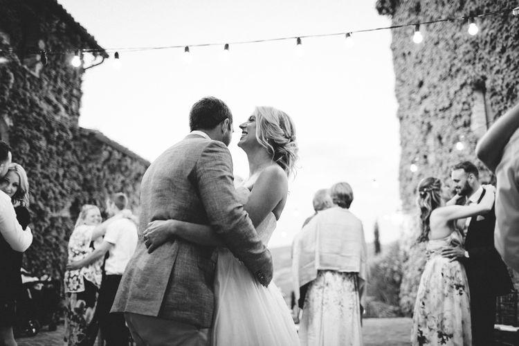 First Dance   Bride in Lyn Ashworth Wedding Dress   Groom in Light Blue Jacket   Outdoor Wedding at Borgo Bastia Creti in Italy   Paolo Ceritano Photography