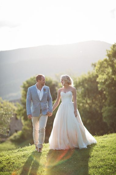 Sunset   Bride in Lyn Ashworth Wedding Dress   Groom in Light Blue Jacket   Outdoor Wedding at Borgo Bastia Creti in Italy   Paolo Ceritano Photography