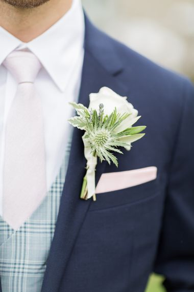 Elegant White Buttonhole For Groom With Navy Suit