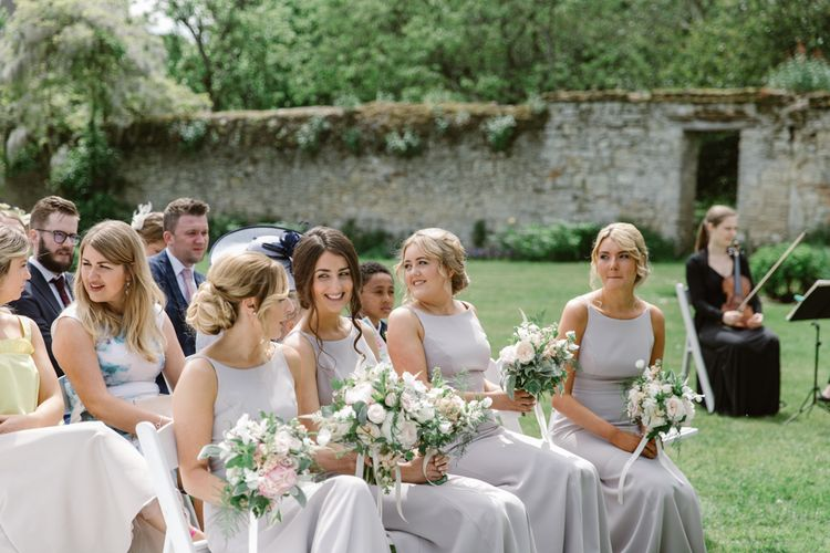 Bridesmaids in Taupe Dessy Dress | Elegant Notley Abbey Wedding | Natalie J Weddings Photography