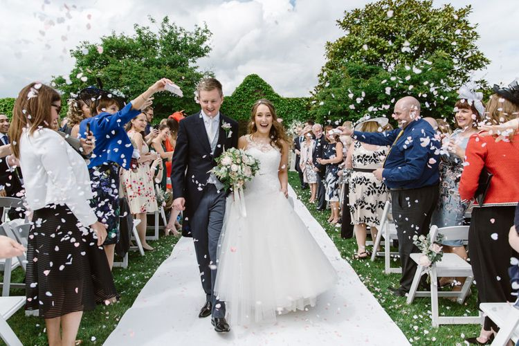 Confetti Moment | Bride in Pronovias | Groom in Moss Bros Suit | Elegant Notley Abbey Wedding | Natalie J Weddings Photography