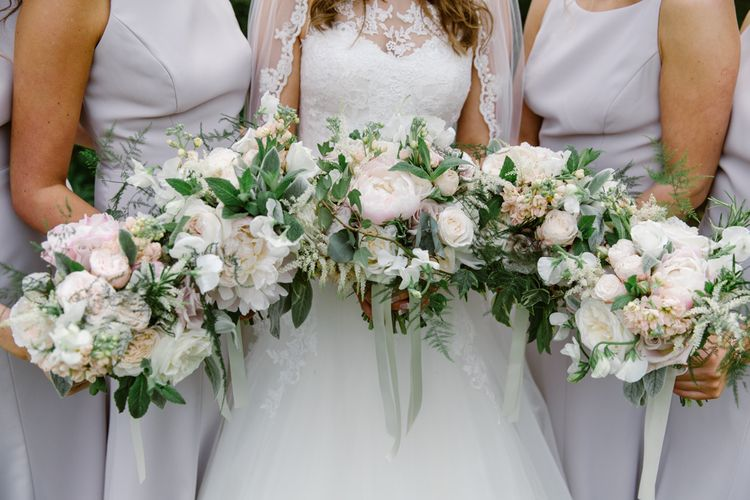 Romantic Blush Floral Bouquets | Bridesmaids in Taupe Dessy Dresses | Elegant Notley Abbey Wedding | Natalie J Weddings Photography