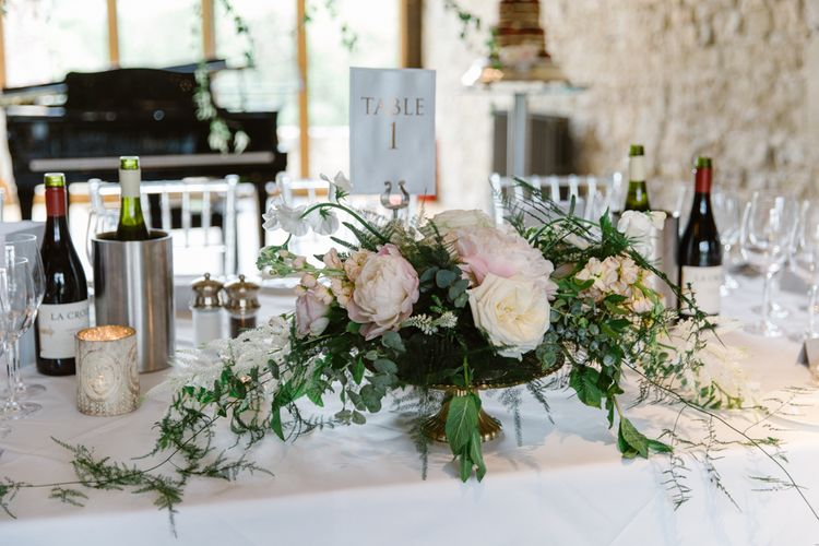 Romantic Pink Flower Centrepiece | Elegant Notley Abbey Wedding | Natalie J Weddings Photography
