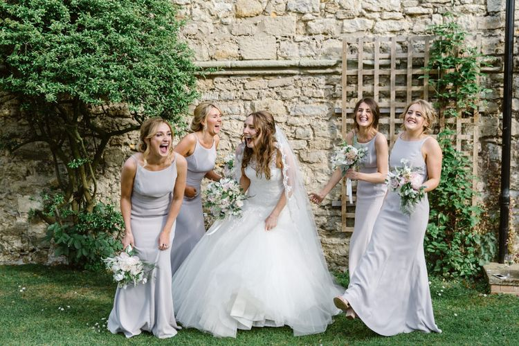 Bride in Pronovias Gown | Bridesmaids in Dessy Dresses | Elegant Notley Abbey Wedding | Natalie J Weddings Photography
