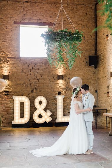 First Dance with Giant Light Up Letters | Bride in Heaton Wtoo by Watters Gown | Groom in ASOS Suit | Marble, Copper & Greenery Wedding at Cripps Barn Cotswolds | Summer Lily Studio Photography