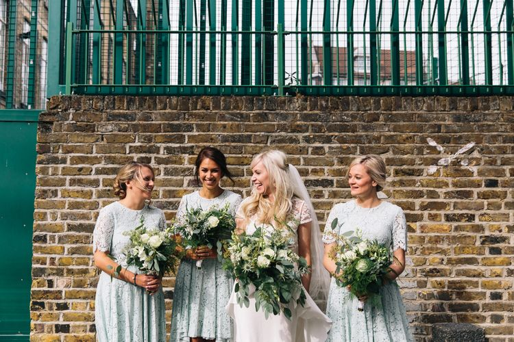 Bridesmaids in Mint Green High Low Lace ASOS Dresses | Bride in Alice Temperley Bluebell Gown | Stylish London Wedding | Eclection Photography