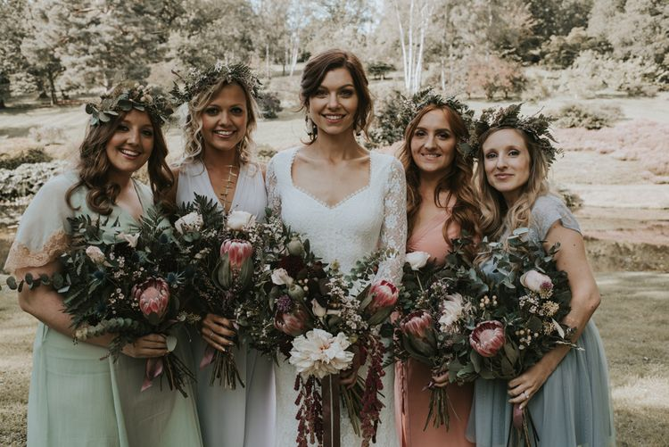 Bride and Bridesmaids Florals | Boho Bride in Dreamers and Lovers Dress | Images by Louise Scott