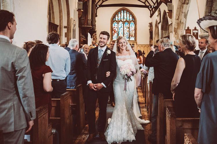 Church Wedding Ceremony | Bride in Lace Dress from Isabella Grace Bridal Boutique | Groom in Victor Valentine Suit | Lemonade Pictures
