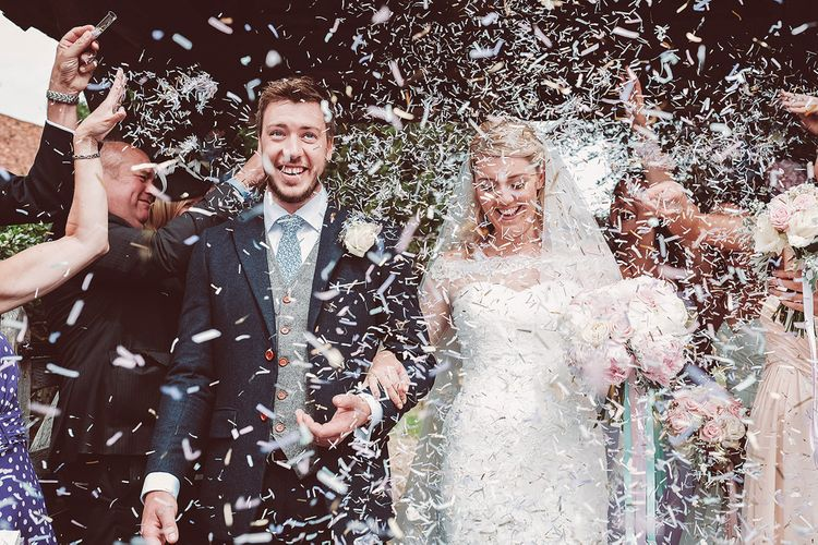 Confetti Moment | Bride in Lace Dress from Isabella Grace Bridal Boutique | Groom in Victor Valentine Suit | Lemonade Pictures