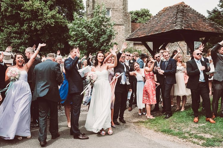 Wedding Guests in Church Courtyard | Lemonade Pictures
