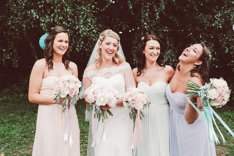Bride in Lace Dress from Isabella Grace Bridal Boutique | Bridesmaids in Pastel Kelsey Rose Dresses | Lemonade Pictures