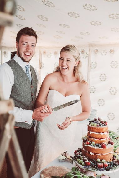 Cutting the Cake | Marquee Reception at Wise Wedding Venue in Kent | Lemonade Pictures