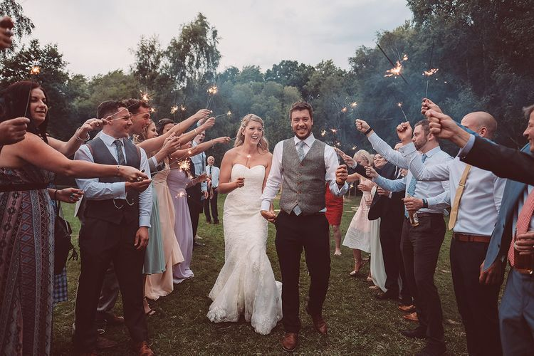Sparkler Exit | Bride in Lace Dress from Isabella Grace Bridal Boutique | Groom in Victor Valentine Suit | Lemonade Pictures