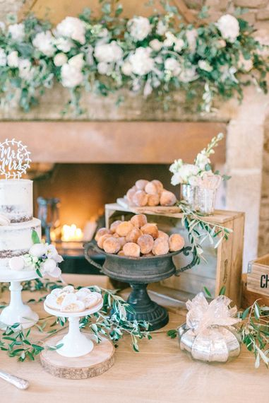 Epic Dessert Table For Wedding With Lots Of Foliage