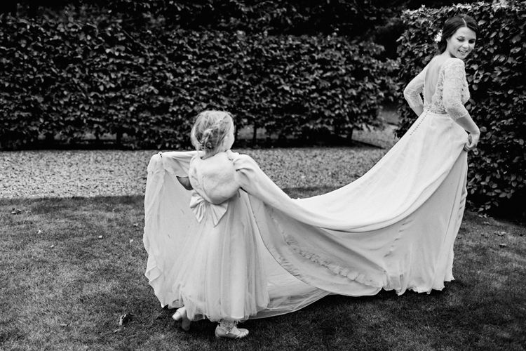 Flower Girl With Bride In Pronovias Image by Steve Gerrard Photography