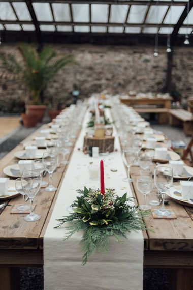 Christmas Wedding Styling Rustic Wooden Tables & Red Candles With Foliage