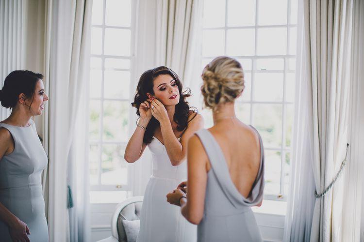 Bridal Preparations | Bride in Karen Willis Holmes Gown | Bridesmaids in Grey Katie May Bridesmaid Dresss | RS Brown Photography