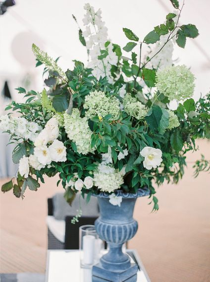 Floral Arrangement In Urn // Elegant & Classic Sail Cloth Tent Wedding At Wickham House With Bride In Pronovias And Images From Fine Art Photographer Julie Michaelsen