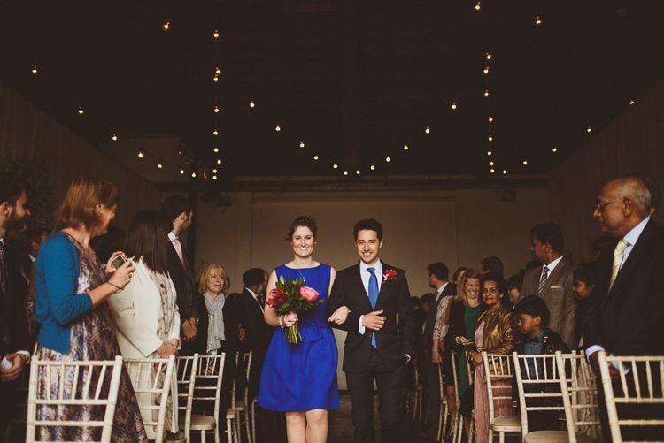 Wedding Ceremony | Bridesmaid in Cobalt Blue Ted Baker Dress | Tropical Trinity Buoy Wharf Wedding | Matt Penberthy Photography