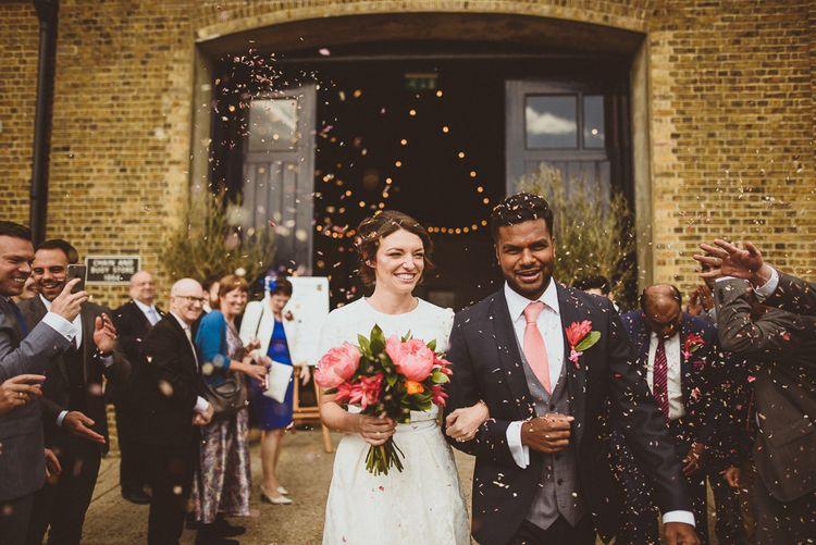 Confetti Moment | Bride in Ted Baker Separates | Groom in Hugo Boss | Tropical Trinity Buoy Wharf Wedding | Matt Penberthy Photography