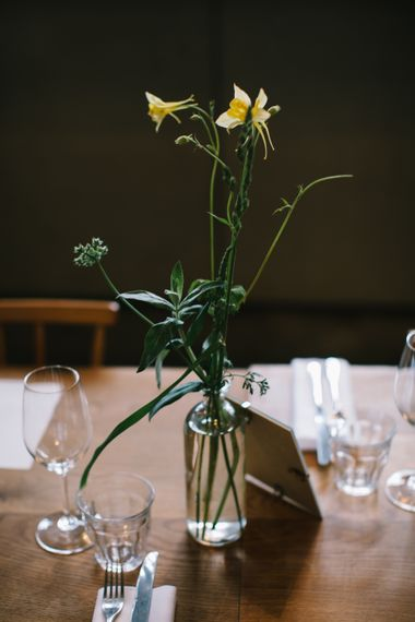 Yellow Flower Stems in Vases