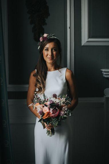 Bride in Charlie Brear Torum Gown with Flower Crown & Bouquet