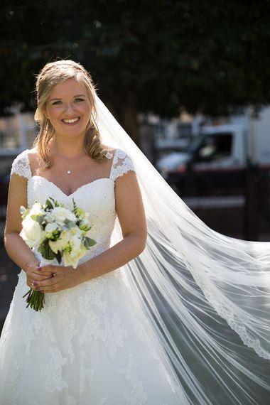 Classic Bride in Lace Mon Cheri Bridal Gown
