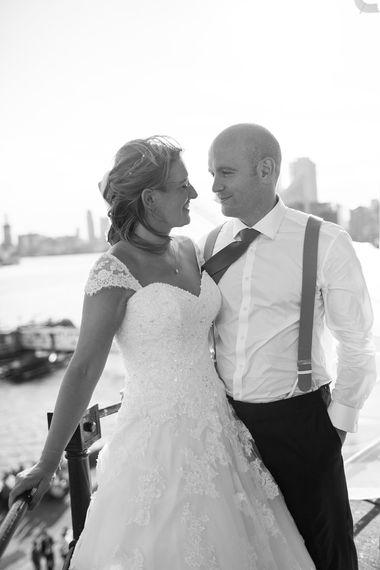 Bride in Lace Mon Cheri Wedding Dress & Groom