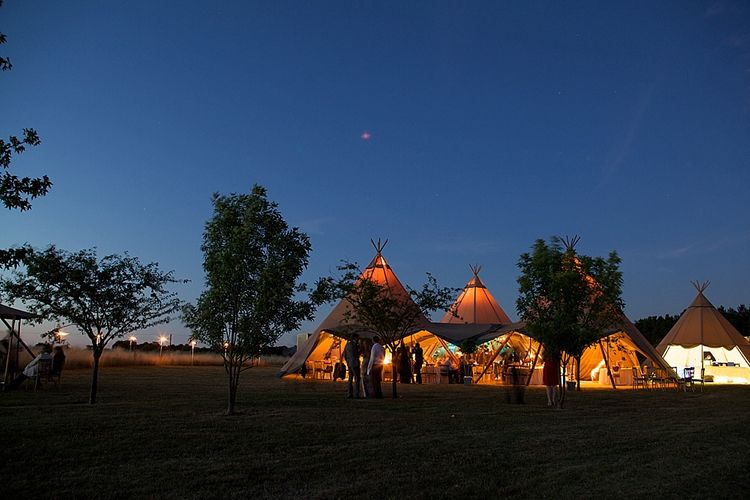 "Tipi at night from <a href=""https://www.stunningtents.co.uk/"" target=""_blank"">Stunning Tents</a>"