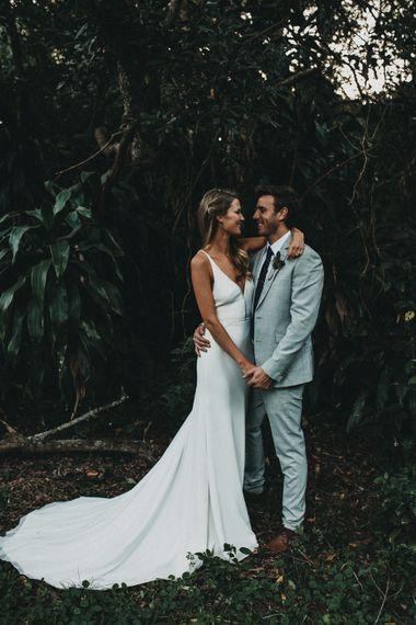 Bride in Bespoke Julia Ferrandi Backless Wedding Gown | Groom in Grey Woolworth Suit | Outdoor Woodland Wedding in South Africa | Michigan Behn Photography