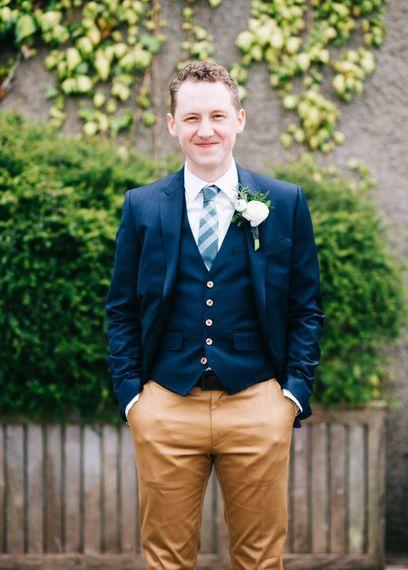 Groom in Tan Paul Smith Trousers & Ted Baker Waistcoat & Jacket | Rachel Joyce Photography