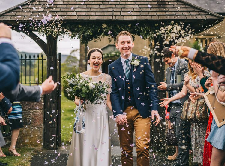 Confetti Moment | Bride in Halfpenny London Thea Dress & Berry Lace Jacket | Groom in Tan Paul Smith Trousers & Ted Baker Waistcoat & Jacket | Rachel Joyce Photography