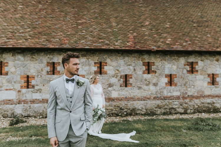 Groomswear // Light Grey Suit With Matching Waistcoat And Navy Bowtie