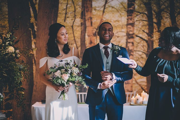 Wedding Ceremony | Bride in Reformation Poppy Gown | Groom in Navy Bespoke Club Suit | Stylish London Wedding Planned by Revelry Events | Story + Colour Photography