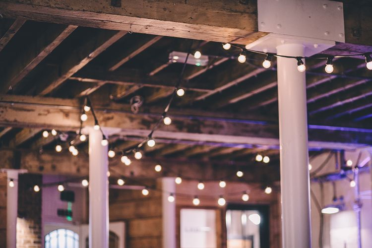 Festoon Lights Wedding Decor | Stylish London Wedding Planned by Revelry Events | Story + Colour Photography