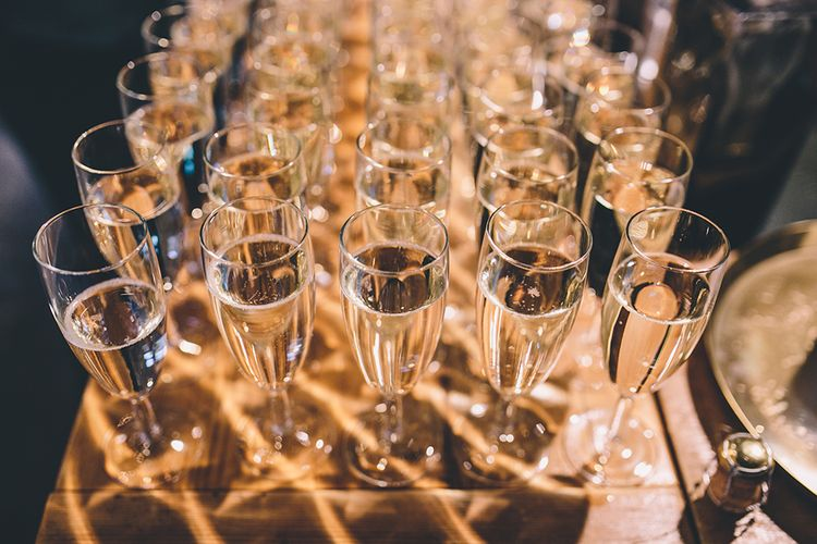 Champagne Glasses | Stylish London Wedding Planned by Revelry Events | Story + Colour Photography