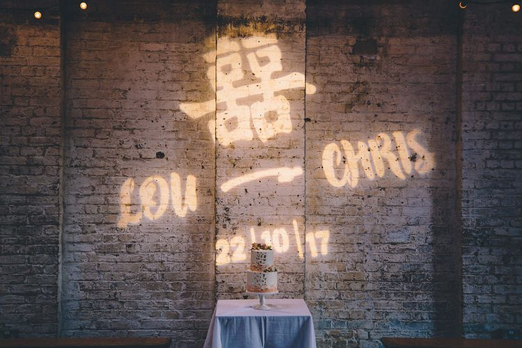 Personalised Light Projection | Stylish London Wedding Planned by Revelry Events | Story + Colour Photography