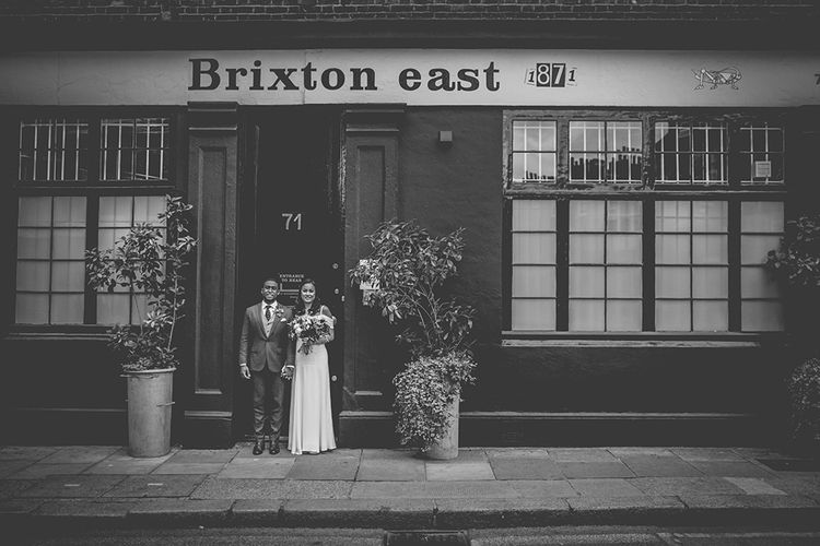Bride in Reformation Poppy Gown | Groom in Tailored The Bespoke Club Navy Suit | Stylish London Wedding Planned by Revelry Events | Story + Colour Photography