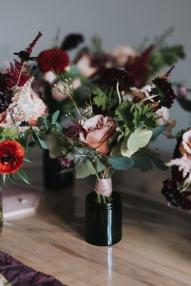 Dusky Pink & Red Flower Stems in Miniature Bottles | Intimate Ceremony at Stoke Newington Town Hall | Miss Gen Photography