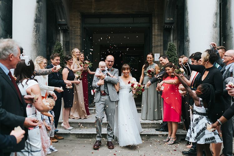 Confetti Moment | Bride in Cymbeline Wedding Dress | Groom in Bailey Nelson Suit | Laid Back Pub Wedding at The Londesborough | Miss Gen Photography
