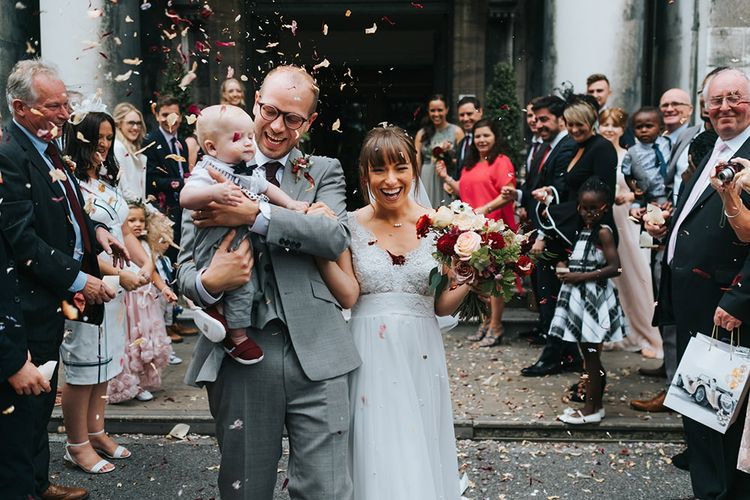 Confetti Moment | Bride in Cymbeline Wedding Dress | Groom in Bailey Nelson Suit | Intimate Ceremony at Stoke Newington Town Hall | Miss Gen Photography