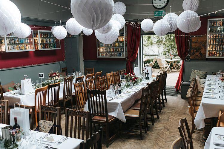 Hanging White Honeycomb Balls | Laid Back Pub Wedding at The Londesborough | Miss Gen Photography