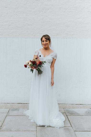 Bride in Cymbeline Wedding Dress | Red Dahlia Bouquet | Laid Back Pub Wedding at The Londesborough | Miss Gen Photography