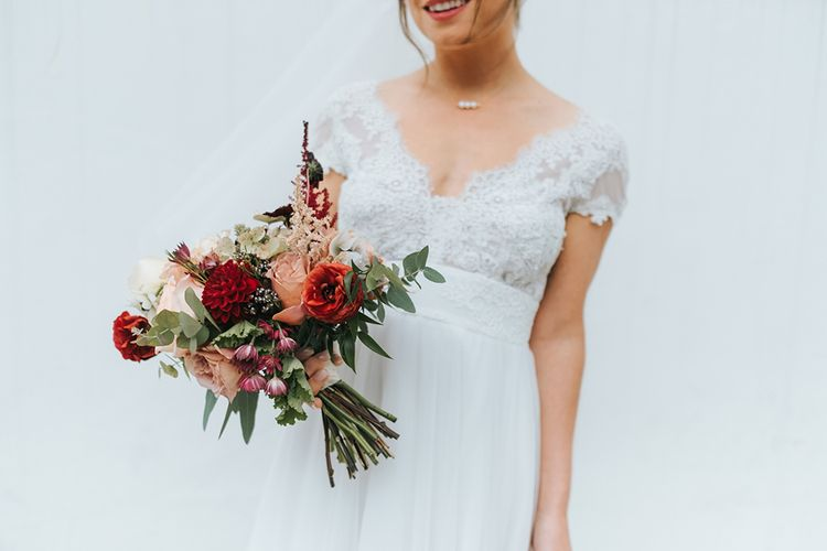Red Bouquet | Bride in Cymbeline Wedding Dress | Laid Back Pub Wedding at The Londesborough | Miss Gen Photography