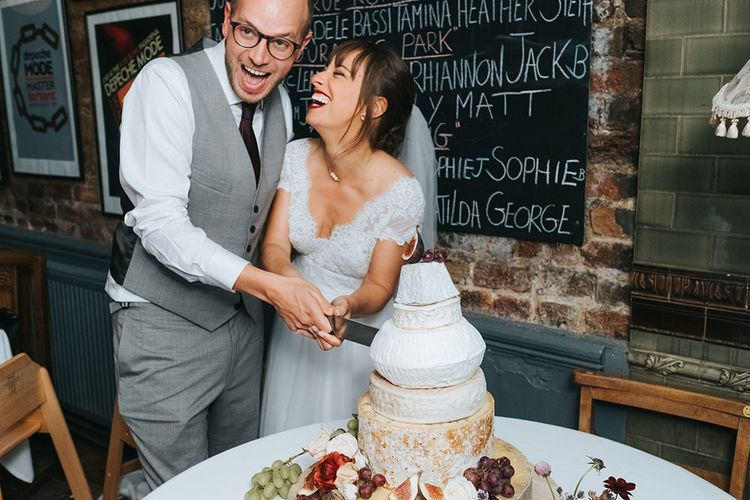 Cutting the Cheese Tower Wedding Cake | Bride in Cymbeline Wedding Dress | Groom in Bailey Nelson Suit | Laid Back Pub Wedding at The Londesborough | Miss Gen Photography
