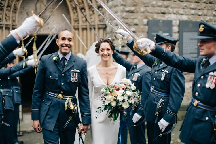 Guard of Honour with Bride in Charlotte Simpson Wedding Dress & Groom in Military Uniform