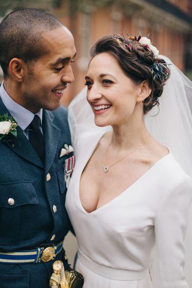 Bride in Charlotte Simpson Wedding Dress & Groom in Military Uniform