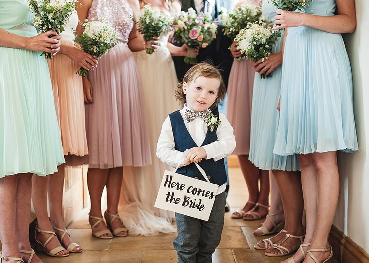 Page Boy With 'Here Comes The Bride' Sign // Rustic Tipi Wedding With Handmade Details At Purbeck Valley Farmhouse With Coastal Tents Tipi And Images From Darima Frampton Photography
