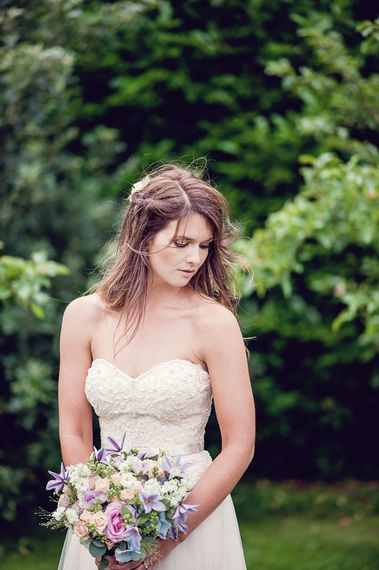 Bride With Flowers In Hair // Rustic Tipi Wedding With Handmade Details At Purbeck Valley Farmhouse With Coastal Tents Tipi And Images From Darima Frampton Photography