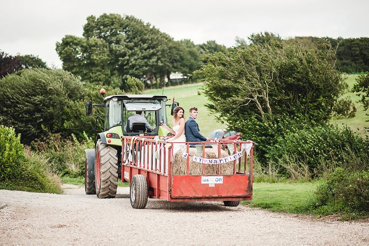 Wedding Transport On Tractor // Rustic Tipi Wedding With Handmade Details At Purbeck Valley Farmhouse With Coastal Tents Tipi And Images From Darima Frampton Photography